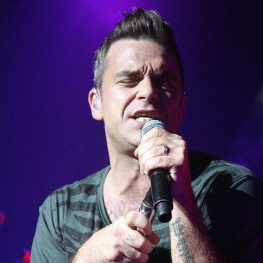 Robbie Williams et sa coupe rockabilly