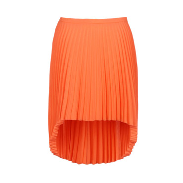 La jupe plissée asymétrique orange Christopher Kane 690 euros sur My Theresa
