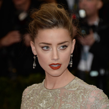 "Amber Heard au Met Gala 2014, pour l'ouverture de l'exposition ""Charles James : Beyond Fashion"", au ""Anna Wintour costume center"", à New York, lundi 5 mai 2014."