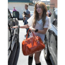 Miley Cyrus et son sac Prada