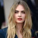Cara Delevingne au défilé Burberry Prorsum à la Fashion Week de Londres pour les collection Printemps été 2015, à Hyde Park le 15 Septembre 2014.