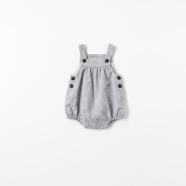 Barboteuse à carreaux collection Mini Zara à 19,95 euros