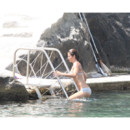 Helena Christensen relaxing with her son Mingus,12, at the beach of luxury hotel Regina Isabella in Lacco Ameno, Ischia Island, Italy