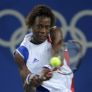 Gael Monfils of France returns the ball to David Nalbandian of Argentina during their men's singles third round tennis match at the Beijing 2008 Olympic Games